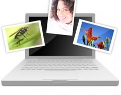 Laptop mit Fotos vor Bildschirm